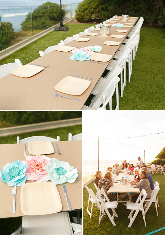 paper flower centerpieces and brown paper covered tables