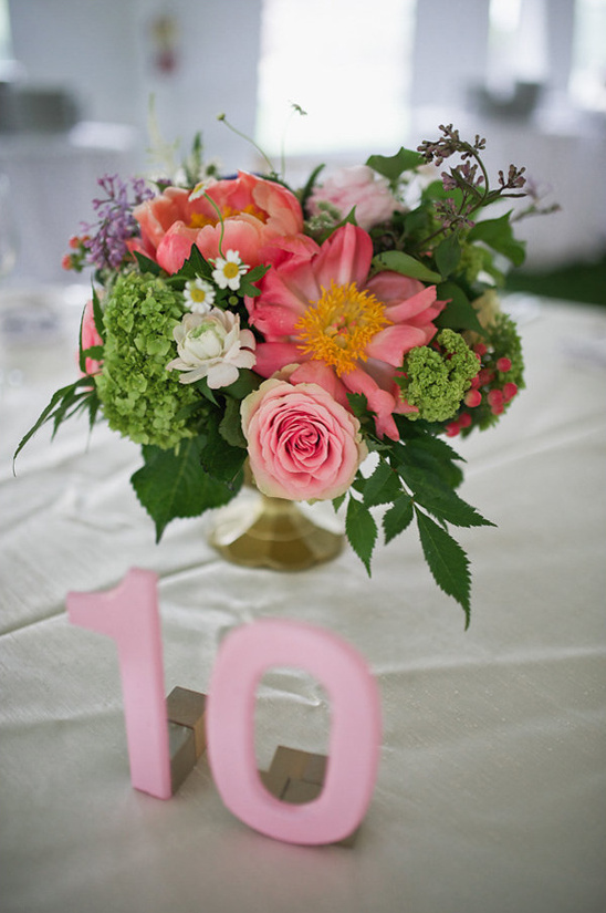 pink table number and bright centerpiece