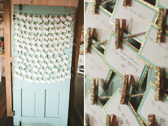 cute gold and teal escort card display