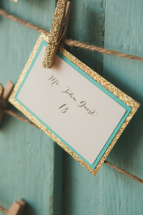 gold and teal escort card