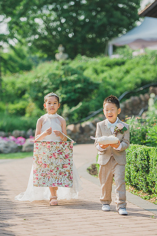 flower girl with banner and ring bearer