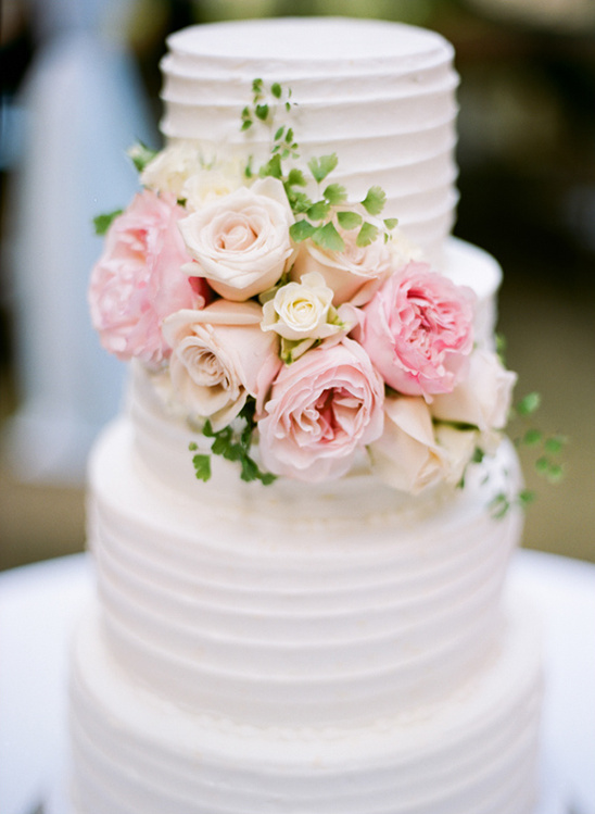 pink and peach rose embellished wedding cake