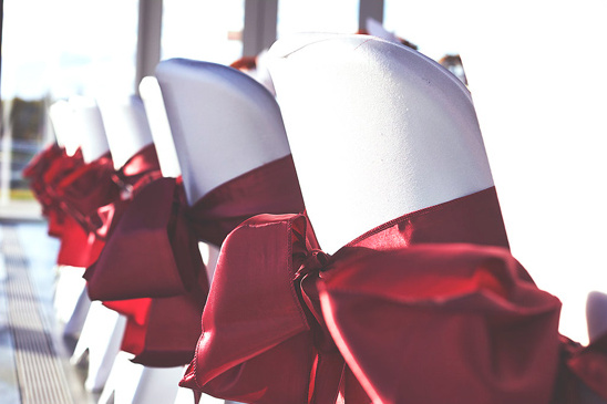red satin seat bows