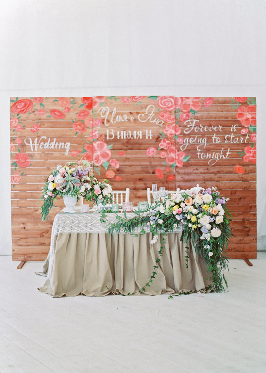 sweetheart table with wood pallet backdrop
