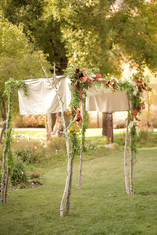 rustic flower covered wedding arch