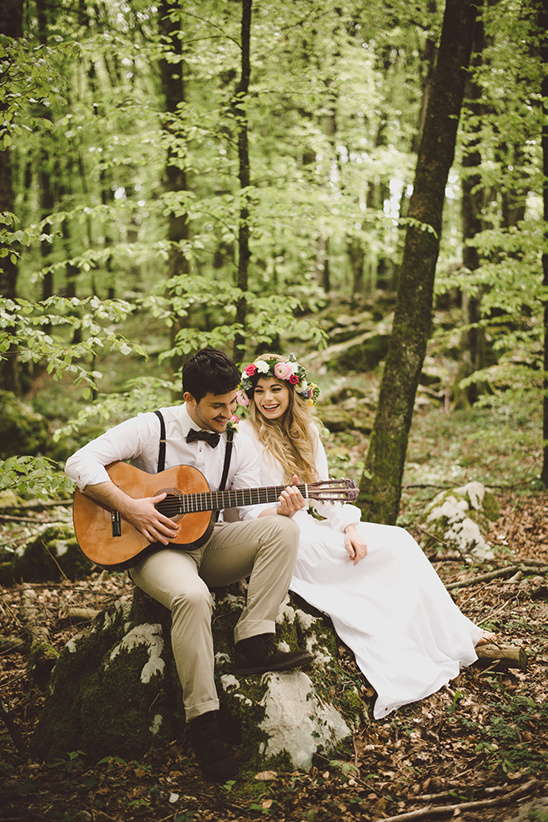 playing guitar in the forest