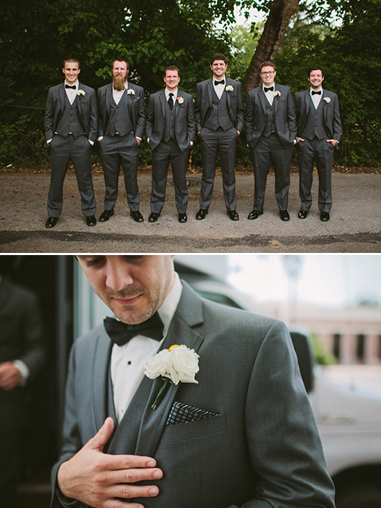 Goom and his men in gray suits with black bow ties