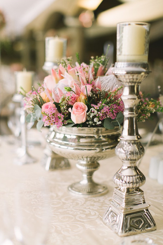 silver candle sticks and pedistal bowl centerpiece