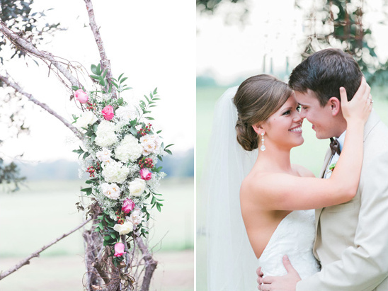 organic flower accented wedding arch