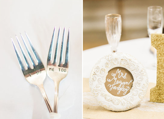 framed seat signs and wedding forks