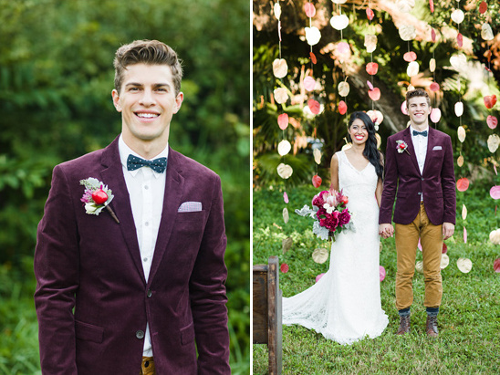 dapper groom in maroon suit jacket