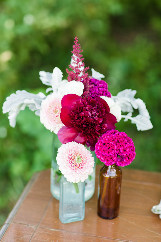 crimson and pink flower arrangement