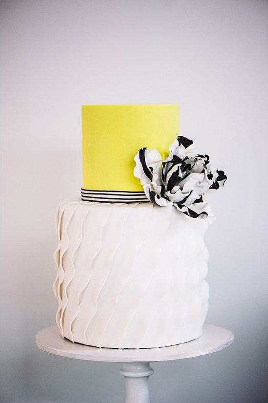 white yellow and black wedding cake