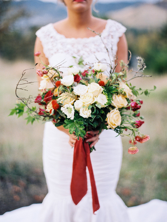 white cream and red wedding bouquet
