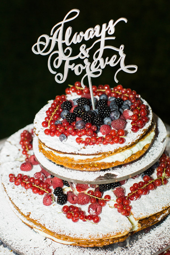 thin layered wedding cake topped with fresh berries