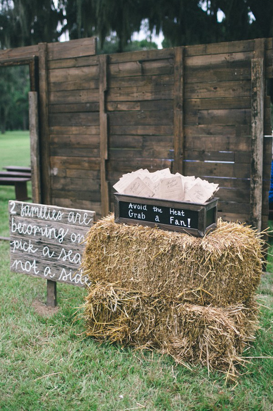 rustic wedding sign and program table