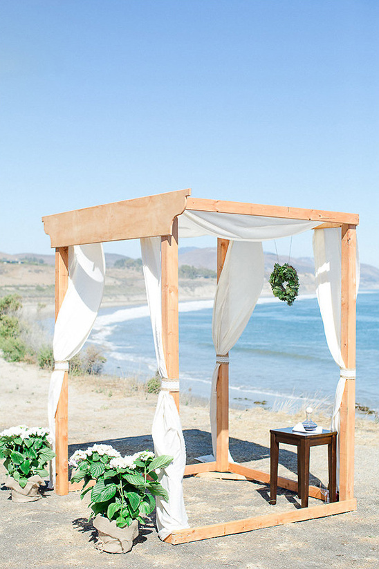 wooden wedding arbor on a cliff