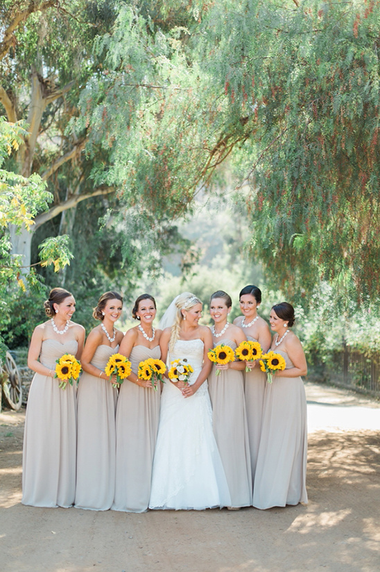 tan bridesmaids dresses with sunflowers