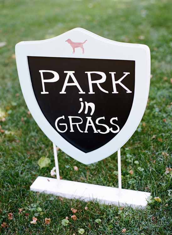 park in grass sign