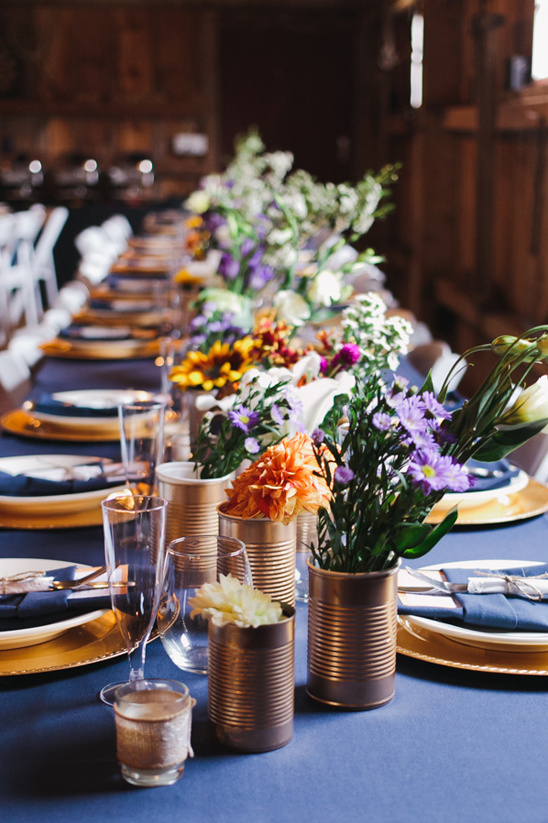 blue and gold table decor with tin can flower arrangements