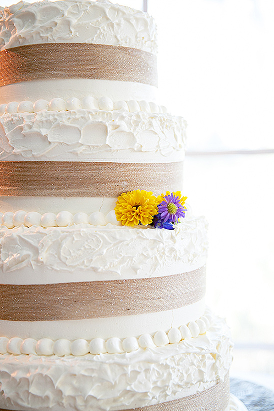 burlap wrapped white wedding cake