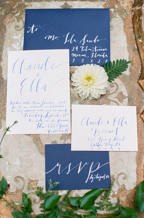 white and navy script wedding invites