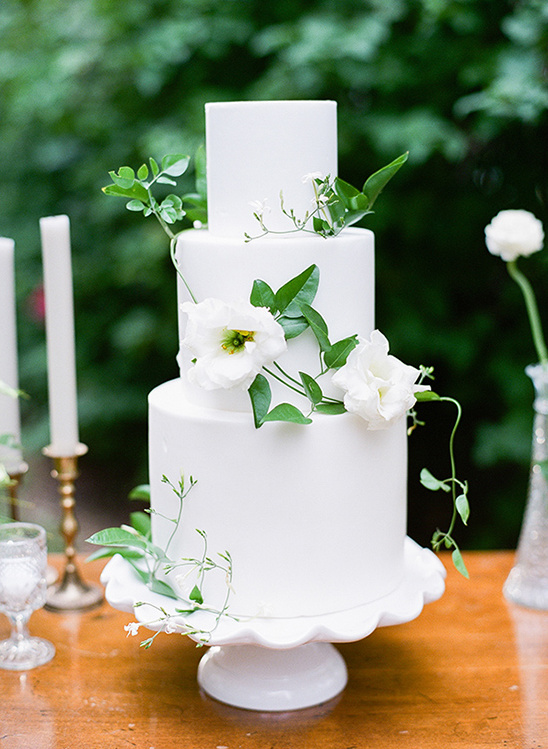 white wedding cake with climbing flowers