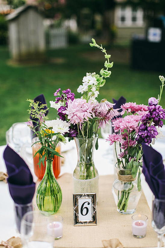 wild flower centerpieces and framed table number