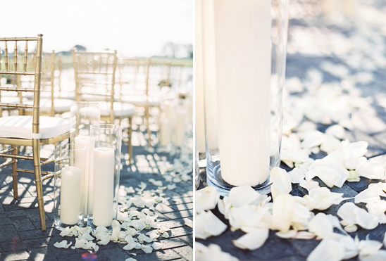 pillar candle and rose petal aisle decor