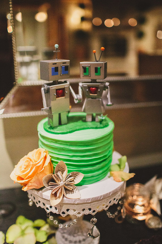 green wedding cake with robot toppers