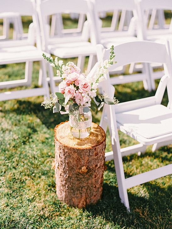 wood stump with floral ceremony decor