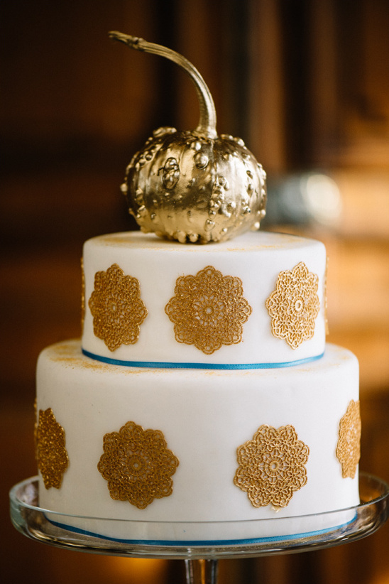 gold pumpkin topped wedding cake