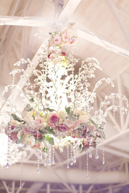 flower accented crystal chandeliere @weddingchicks