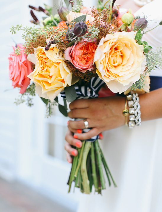 yellow and orange bridal bouquet @weddingchicks