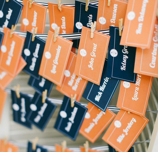 orange and navy escort cards @weddingchicks