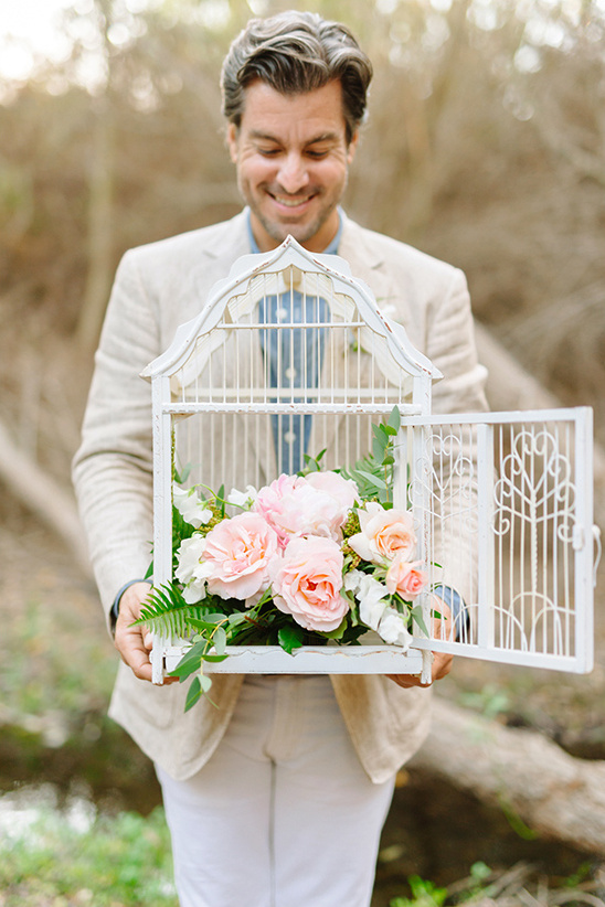 flower filled bird cage @weddingchicks