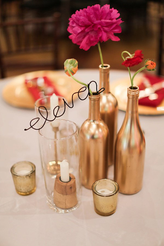 gold bottles with wire table numbers @weddingchicks