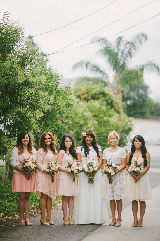 assorted peach and ivory bridesmaid dresses @weddingchicks