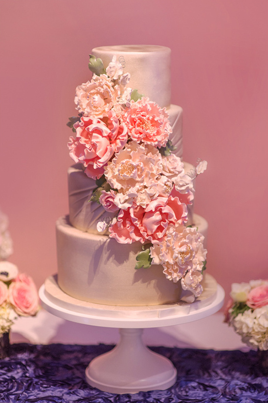 wedding cake with pink floral cascade @weddingchicks