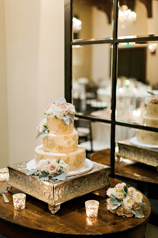 wedding cake with mirror backdrop