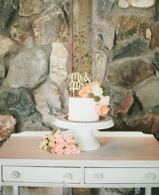 simple flower topped wedding cake @weddingchicks