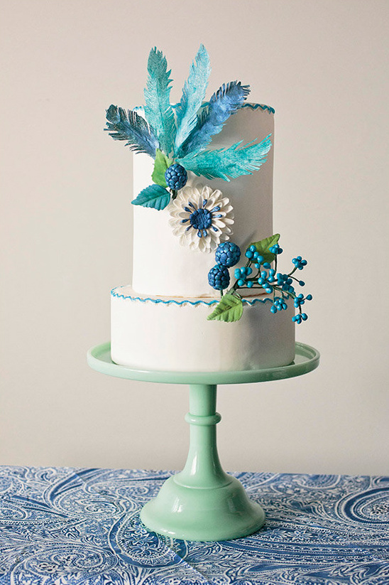 feather and flower accented cake @weddingchicks