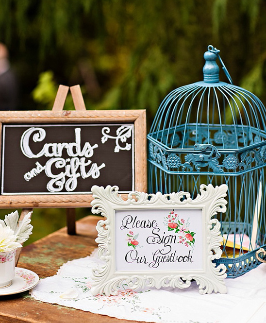 vintage bird cage and welcome sign @weddingchicks