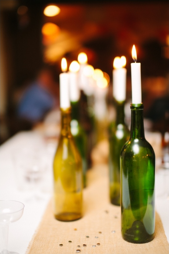 wine bottles holding candles