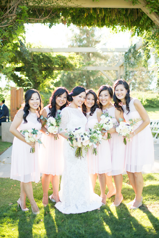 bridesmaids in white cocktail length dresses @weddingchicks