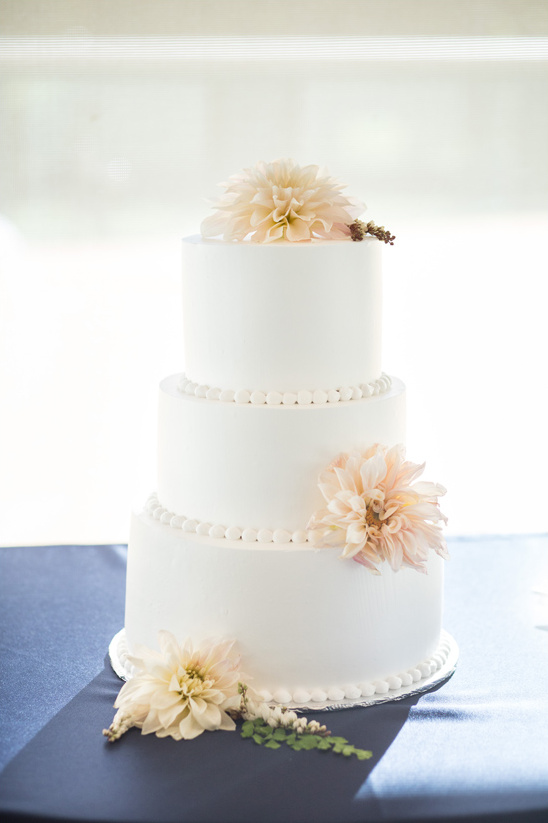 clean dahlia topped wedding cake @weddingchicks