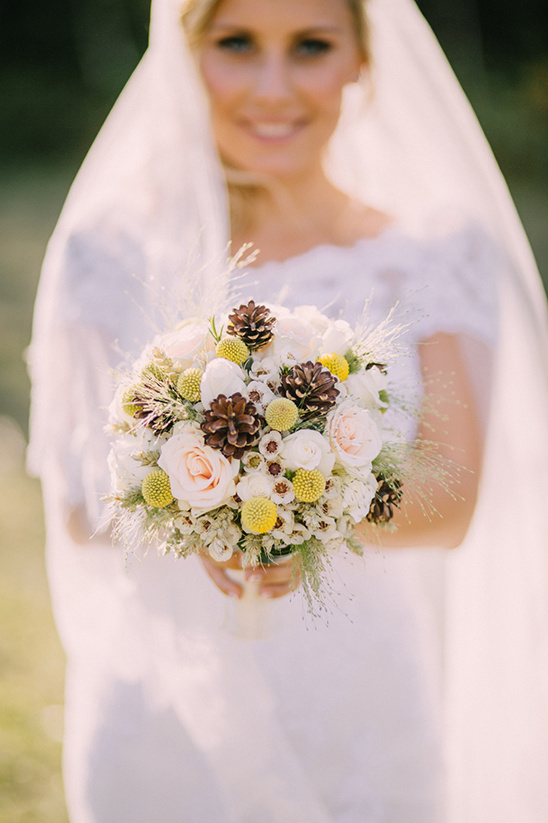 bridal bouquet with pine cones @weddingchicks