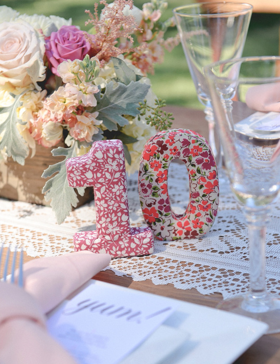 funky patterned table numbers @weddingchicks