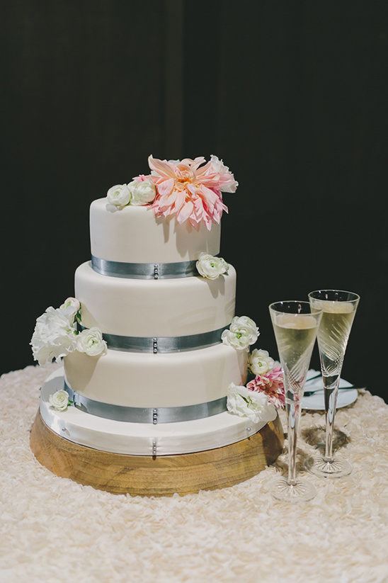 white pink and blue wedding cake by The Cakery @weddingchicks
