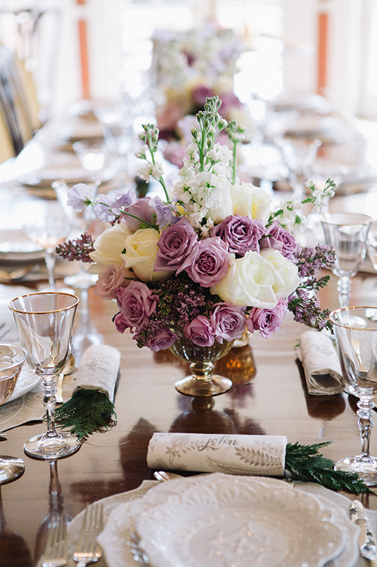 purple florals reception decor @weddingchicks